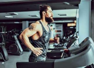 bearded man running on a treadmill