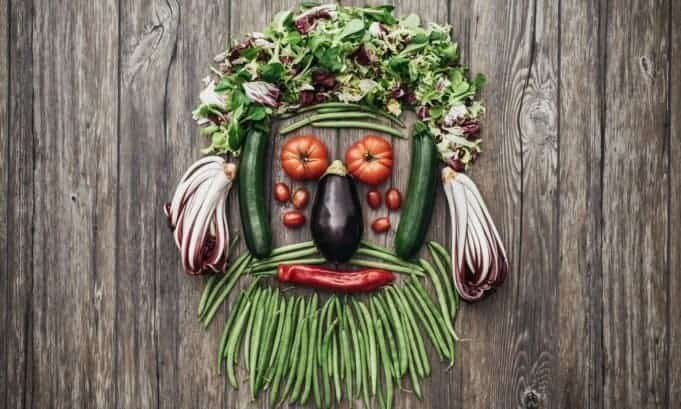 assorted vitamin rich vegetables made into a figure that looks like bearded man