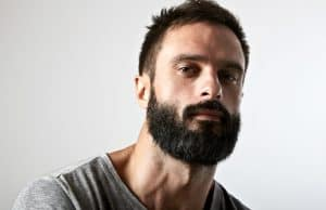 man with thick dark beard