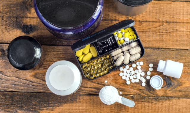 creatine and other supplements on a table
