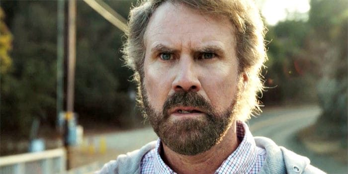 Will Ferrell in grey hoodie and a beard