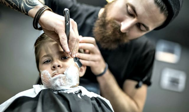 kid getting a shave