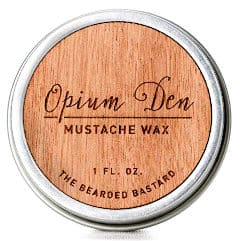 a metal tin of opium den mustache wax isolated