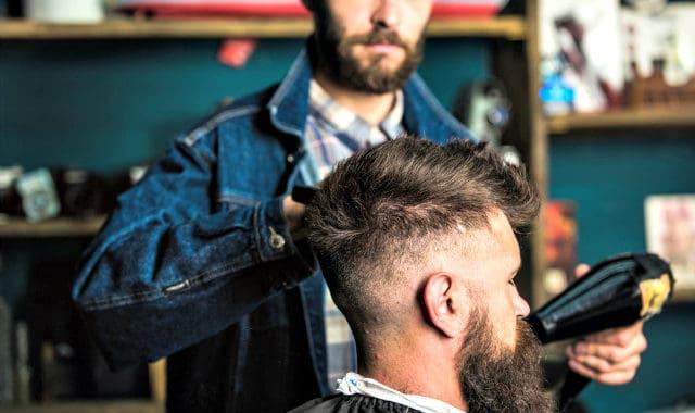 man blow drying beard