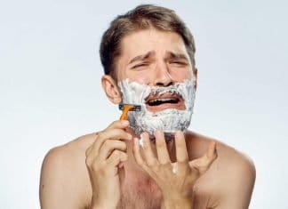 man shaving with razor bumps