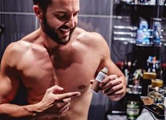 man showing a bottle of beard growth serum