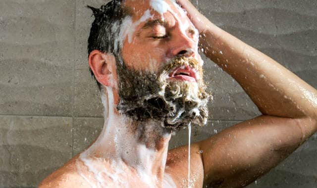 man washing the beard