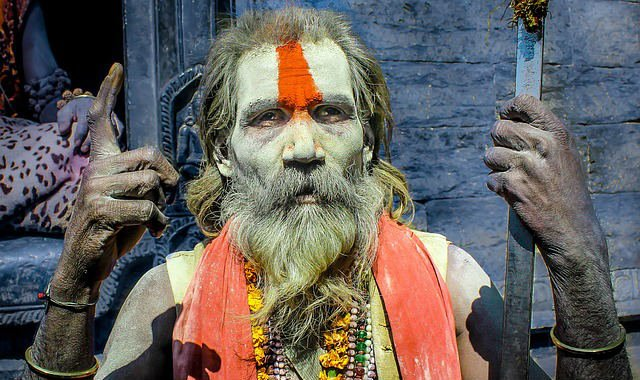 man with colored beard and skin paint