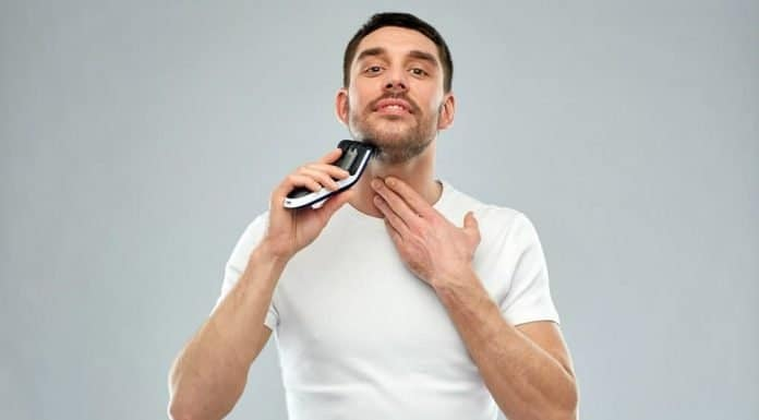 man using a trimmer for stubble