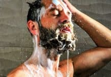 man washing his facial hair with shampoo