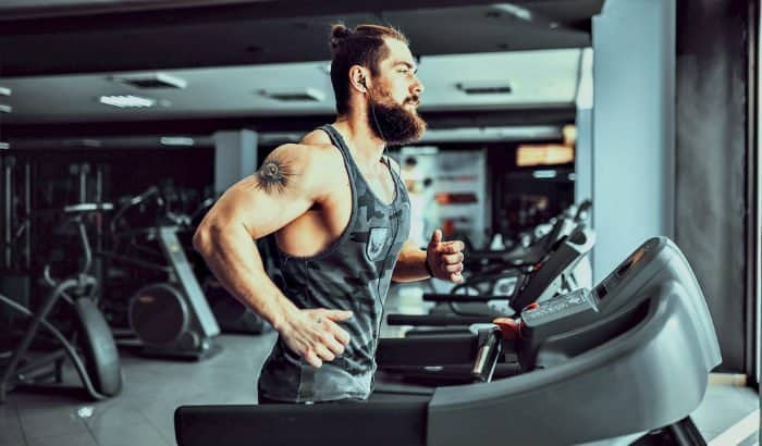 bearded man on a treadmil