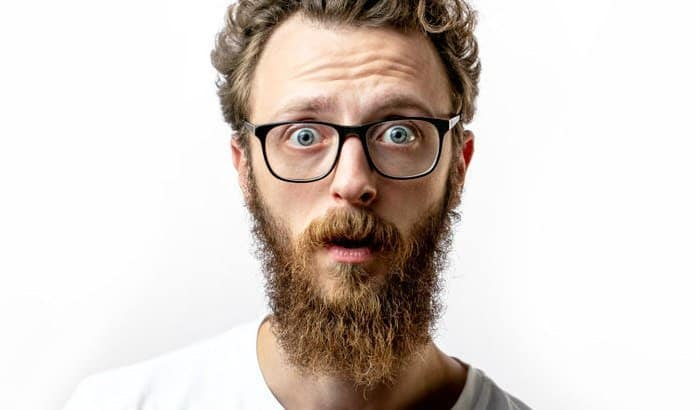man with a curly beard