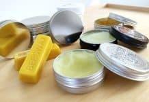 beard balm tins on a table