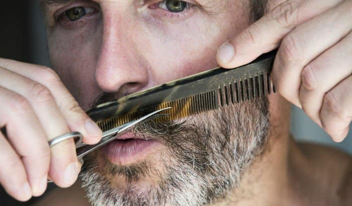 trimming mustache with beard scissors