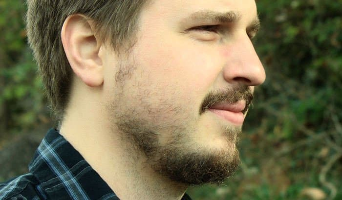 four week beard with slow growing cheeks