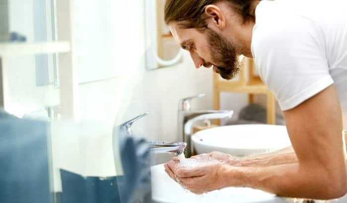 washing the beard over sink